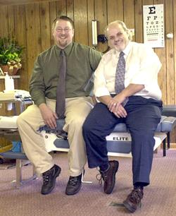 Chiropractors Paul Boris (left), and Andrew Giran pause to talk about their practice at a truck stop near the Interstate 70 exit for Smithton, Pa. - Keith Srakocic/The Associated Press